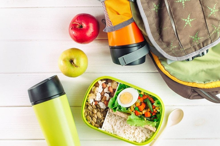 Apples, water bottles, and a pre-prepped meal.